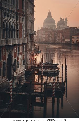 Church Santa Maria della Salute and Grand Canal view at sunrise with boat, Venice, Italy.