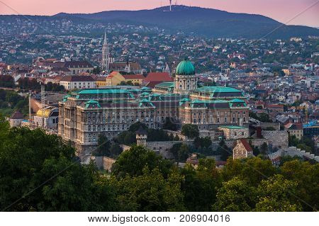 Budapest Hungary - The beautiful Buda Castle Royal Palace with the Buda hills and the Matthias Church at background at sunset