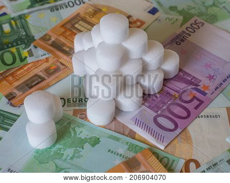 A Stack Of White Cylindrical Pillets On The Bills Of The Eu
