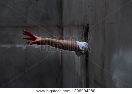 Hand Of Ghost Woman Or Zombie Penetrate Wall