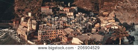 Vernazza panorama with buildings on rocks over sea in Cinque Terre, Italy.