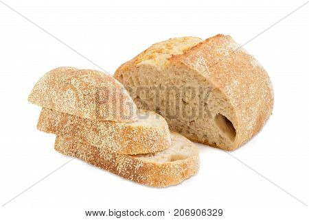 Several slices and half of loaf of the wheat sourdough hearth bread with bran on a white background