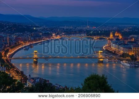 Budapest Hungary - Panoramic skyline view at blue hour of the famous Szechenyi Chain Bridge Margaret Bridge Margaret Island and Parliament of Hungary with Buda Hills at background with colorful sky