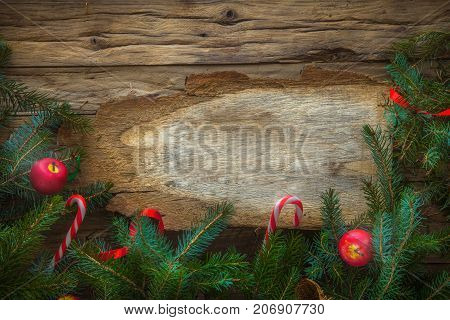New year. Holiday greeting card with rustic wood and ornaments. Xmas backgroud.