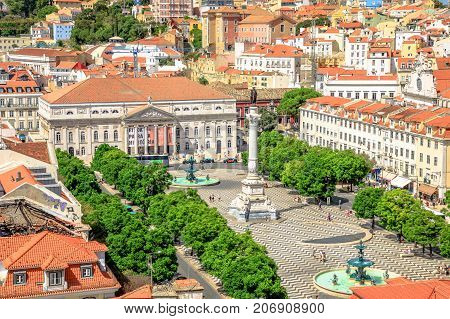 Lisbon, Portugal - August 26, 2017: aerial view of Rossio Square or Pedro IV Square in Lisbon downtown from panoramic platform of Elevador de Santa Justa. Architecture background. Urban skyline.