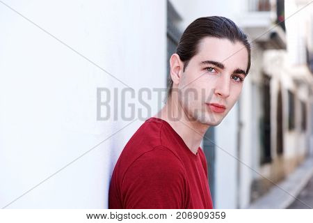 Close Up Serious Man With Long Hair Staring On City Street