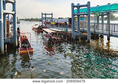 Bangkok, Thailand - December 8, 2015: Nonthaburi Pier - last stop of Chao Phraya Express Boat with Orange Flag.