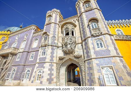 Bottom view of Pena National Palace entrance, in Portuguese Palacio da Pena or Castelo da Pena, Sintra, near Lisbon, in a sunny day. The palace is Unesco Heritage and one of Seven Wonders of Portugal.