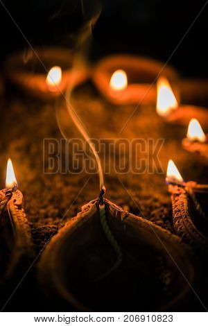 GST effect in India on diwali - diya or oil lamps became costly, oil lamp being extinguished because of lack of oil in diwali festival because of high price
