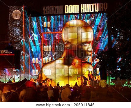 House of worship. Lodz, Poland - September 29, 2017 Effective, extremely colorful projection of light on the wall of the Lodz cultural house at the 2017 Light Art Festival in Lodz.