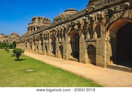 Ancient ruins in Hampi, Karnataka, India. Elephant Stables in Royal Centre is located in the area that lies just outside the Zenana Enclosure.
