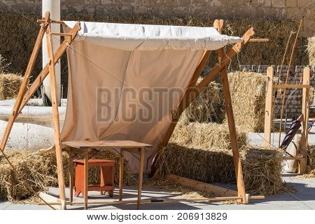 Traditional Medieval encampment setup for archery practice feathered arrows and bow front of traditional ancient medieval straw targets, Medieval Mdina, Malta, April 2017