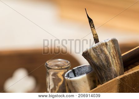 Traditional historical medieval writing calligraphy illumination tools, ink horn and nib
