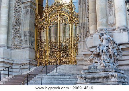 PARIS, FRANCE - JUNE 11, 2017: Iconic Petit Palais Gate near famous Alexander III bridge