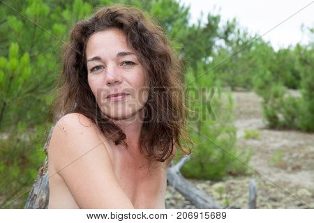 Naked Beautiful Woman With Long Brown Hair Sitting And Smiling