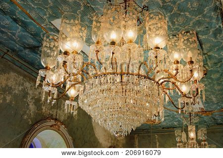 Goa, India - November 16, 2012: Menezes Braganza Pereira House - colonial Villa-Museum of Portuguese era with decoration of 16-18 century. Ancient crystal chandelier in the living room