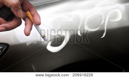 Background anti smoking campaign graphic design The cigarette in finger and graphic smoke design the under has copy space.