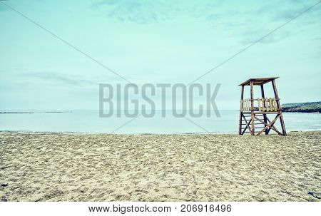 Empty sandy beach with lifeguard tower, Crete, Greece.
