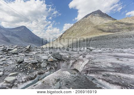 Slit in glacier Akkem landscape. Altai mountains. Russia