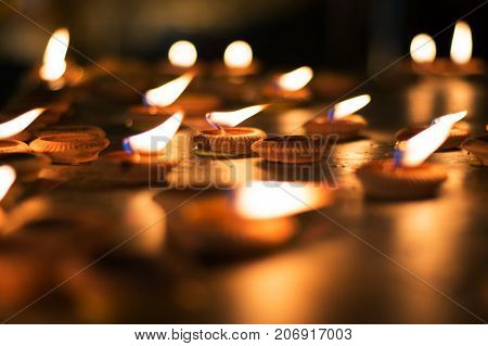 Close up Light bulbs or Lighted candle to worship the Buddha in night time