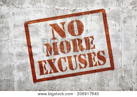 no more excuses - graffiti sign with arrow on stucco wall