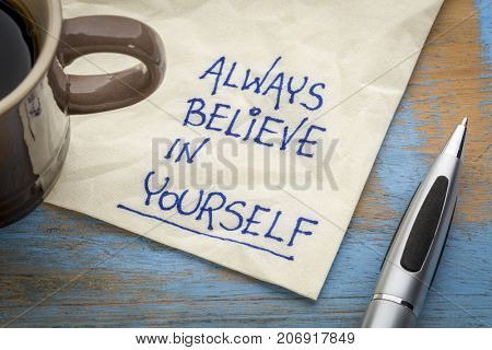 Always believe in yourself - handwriting on an napkin with a cup of coffee