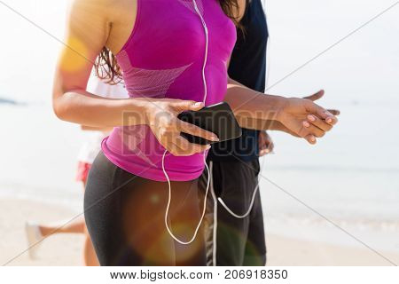 Group Of People Runners On Beach Closeup Of Young Sport Runners Jogging Together Working Out At Seaside, Fit Male And Female Joggers Body Shot