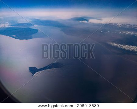 Imrali, also Imrali is a small island in the southeastern part of the Marmara Sea. Panorama Sea of Marmara, view from an airplane,  island, the water surface, land, clouds