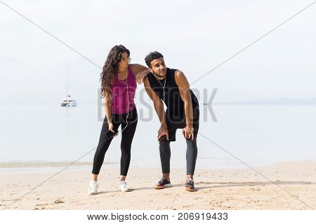 Couple Of Runner Having Rest After Training On Beach Man And Woman Sport Runners Standing Fit Male And Female Fitness Jogger On Seaside Together