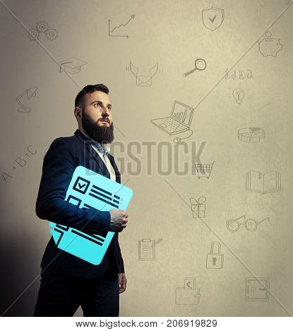 Bearded man in a business suit is holding a questionnaire icon in his hands. Background with hand-drawn illustrations on a business theme. Concept of sociological research questioning testing.