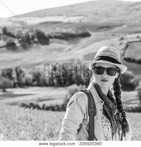Active Woman Hiker In Hat With Bag Enjoying Tuscany View