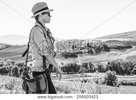 Healthy Woman Hiker Hiking In Tuscany Looking Into Distance