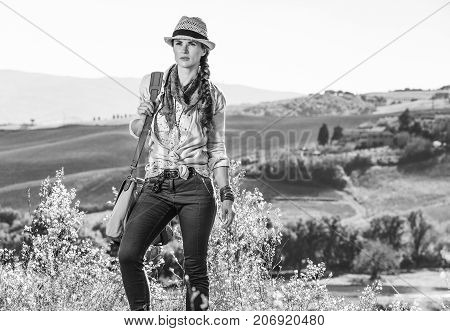 Active Woman Hiker On Tuscany Hike Looking Into Distance