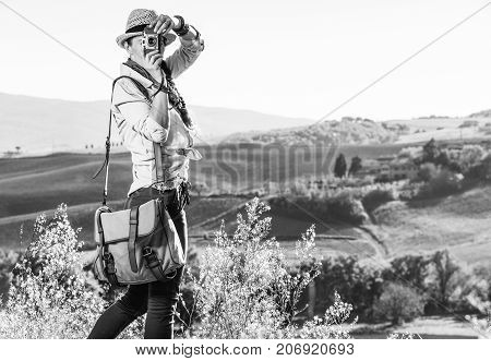 Woman Hiker In Tuscany Taking Photo With Vintage Photo Camera