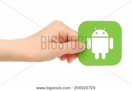 Kiev Ukraine - May 18 2016: Hands holds Google Android icon printed on paper. Android is a mobile operating system developed by Google