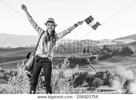 Smiling Young Woman Hiker On Tuscany Hike With Italian Flag