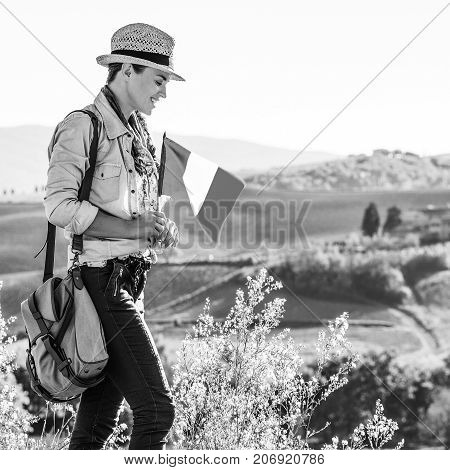Smiling Woman Hiker With Italian Flag Enjoying Tuscany View