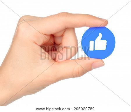 Kiev Ukraine - September 04 2017: Hand holds Facebook Like Empathetic Emoji Reaction printed on paper. Facebook is a well-known social networking service