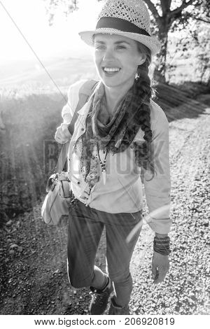 Happy Active Woman Hiker In Hat On Tuscany Hike