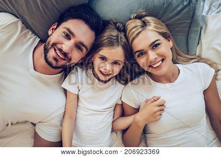 Family In Bedroom