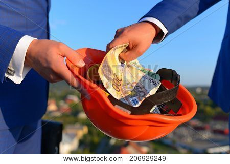 Bribery And Business Bargain Concept. Businessmens Hands With Money