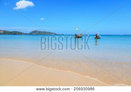Long tail boats at the beautiful beach in Phuket Thailand