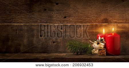 First and second Advent candles burning Advent or Christmas background with space for text or image