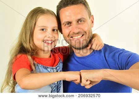 Schoolgirl And Dad Beat Fists In Agreement. Childhood And Family