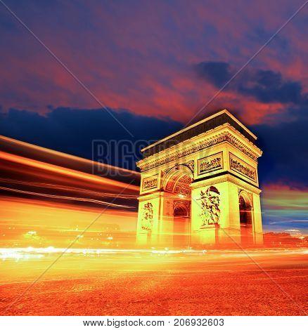 Famous Arc De Triomphe At Night In Paris, France