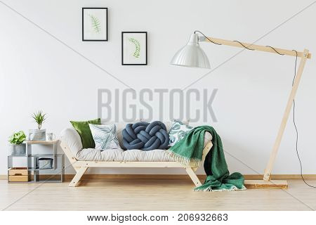 Wooden Couch And Green Blanket