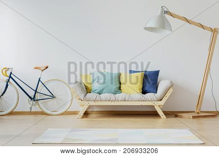 Colorful Pillows On Wooden Couch
