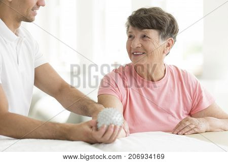 Patient Holding Spiked Rehabilitation Ball