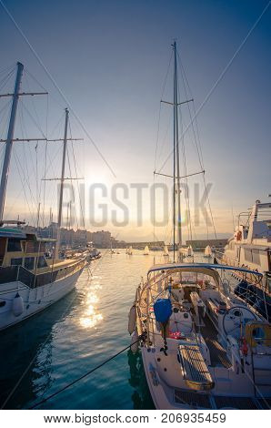 Sailing boats docked at Heraklion harbour, Crete, Greece.