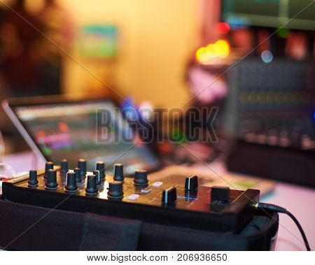 Sound mixing controller for hip hop dj to scratch records, mix live music tracks at night party.Dj audio mixer knobs for nightclub event.Disc jockey control and regulate audio volume level